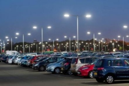 Parking lot of international airport enlightened by LEDs